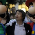 "(FILES) In this file picture taken on October 25, 2012 Japanese video game designer Shigeru Miyamoto (C) grimaces as he poses with arcade game stars Mario Bros and Luigi at the Jovellanos Theatre in Gijon, , to participate in a tribute to the video game, on the eve of the Prince of Asturias 2012 Award ceremony.  ""Super Mario"", the iconic little plumber featured in the hit video game by Nintendo, will mark on September 13, 2015, 30 years since its initial release, with a new version drawing from the creativity of its players.  AFP PHOTO/ MIGUEL RIOPA"