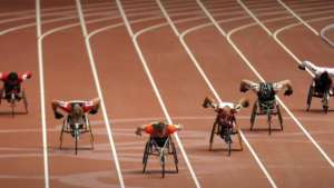 Athletes compete in a heat of the men's 400m T54 event during the 2008 Beijing Paralympic Games at the National Staidium in the Chinese capital on September 8, 2008. AFP PHOTO/Peter PARKS / AFP PHOTO / PETER PARKS